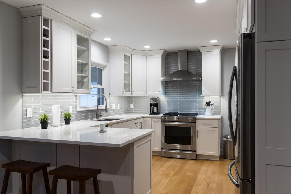 Modern Custom Kitchen Remodel with Blue Back Splash in West Michigan
