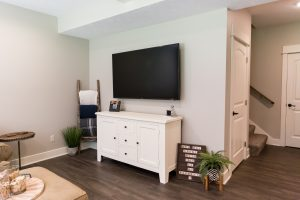TV and white entertainment center inLiving Space Remodel in West Michigan